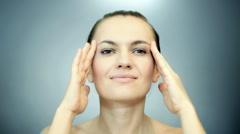 Beautiful woman massaging her head Stock Footage