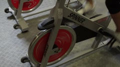 Group working out on bicycles in a gym Stock Footage