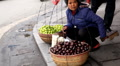 Colourful Street Food Life in Hanoi, Vietnam, A woman selling chestnuts Footage