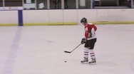 Stock Video Footage of Ice Hockey Player Controls Puck