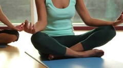 Yoga students practicing yoga in yoga studio Stock Footage