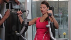 Female and male coach, working out in gym Stock Footage