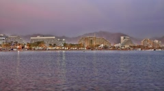 Skyline of Eilat: coastline, beach, hotels, mountains and bay time lapse Stock Footage