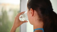 Girl drinking clean water Stock Footage