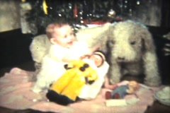 Baby Girl Under The Christmas Tree (1939 Vintage 8mm) Stock Footage