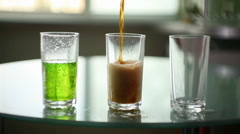 Fill the glass with carbonated beverages Stock Footage