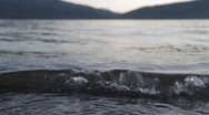 Stock Video Footage of Gentle Waves at the Lake