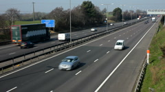 Traffic on the M1 Motorway dual carriageway.  Northamptonshire England UK Stock Footage
