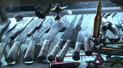 Arabic knives, guns, lamps for sale in the shop - stock footage