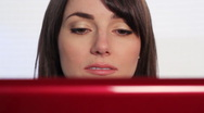Woman at computer nodding off.  Stock Footage