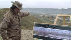 Stock Video Footage of Soldier oversees the ground using a map in Afghanistan