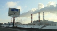 Tracking shot of smoke stacks of plants in Moscow city Stock Footage