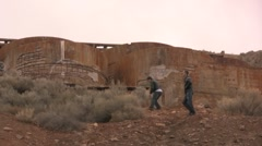 2 guys hike up to an abandoned metal refinery - stock footage