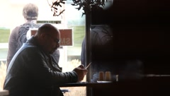 Man texting in restaurant Stock Footage