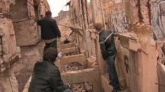 Boy band photo shoot at abandoned building - stock footage