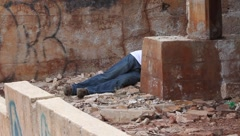 Dead body at an Abandoned refinery building Stock Footage