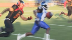 American football back runs ball and tackled slow motion - stock footage