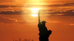 Stock Video Footage of Statue of Liberty in Dramatic Sunset with Sun Behind Torch