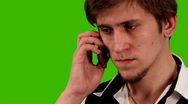 Man with a cell phone on a green background Stock Footage