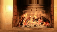Fire firewoods and smoke coals inside fireplace Stock Footage
