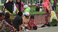Families relax outside Mosque Stock Footage