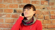 Woman talking on cellphone Stock Footage