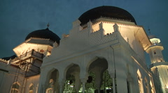 Mosque at night with call to prayer Stock Footage