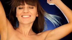 Attractive sexy woman dancing with wind in her hair, slow motion Stock Footage