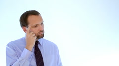 Portrait of a thinking businessman, isolated   Stock Footage