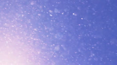 Wind and snow on blue sky background Stock Footage