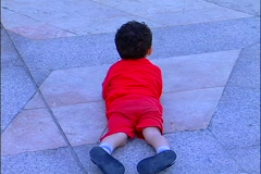 Muslim boy on square floor outside Hassan Mosque II Stock Footage