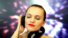 Elegant beautiful woman with headphones on sparkling background Stock Footage