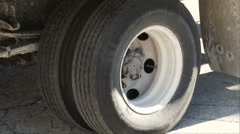 Truck stops spinning wheels Stock Footage