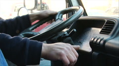 Driver steering a truck - stock footage