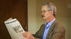 Man Reading Newspaper Falls Stock Footage