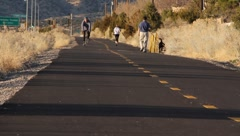Cyclist, Jogger, Dog Walker Stock Footage