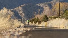 Desert Street Cyclists Stock Footage