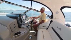 Man Piloting Boat Stock Footage