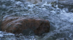 Mountain winter torrent with water running over heavy rocks Stock Footage