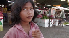 Cambodia: Poor Sad girl in Marketplace Stock Footage