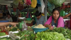 Cambodia: Woman sells bean sprouts. Stock Footage