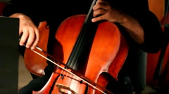 Close-up view on violoncello in orchestra Stock Footage