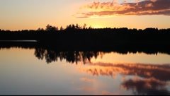 Reflection of beautiful sunset in forest lake with bird's songs Stock Footage