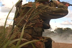 WWII Soldiers firing (lots of shells) Stock Footage