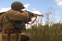 WWII Soldier firing BAR Stock Footage