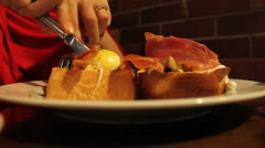 Woman eating Eggs Benedict - stock footage