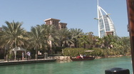 Stock Video Footage of Jumeira With Burj Al Arab and Boat