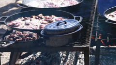 Lamb steaks cooking over open fire P HD 8907 Stock Footage
