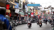 The Bustling Street Scene Of Hanoi, Vietnam, Old Town, Motorcycles, Cars Traffic Stock Footage