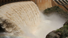 Strong flowing water, dam wall with open sluice gates Stock Footage